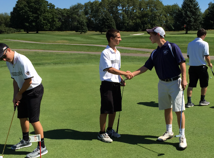Senior Michael Passio shakes his opponent's hand at his match on September 15. Photo by Ray Lingenfelter.