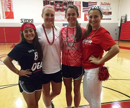 Seniors Maddy Mummert, Ally Kerr, Emily Houska and Julia DeLuca posed in the gym. Photo courtesy of Ally Kerr.