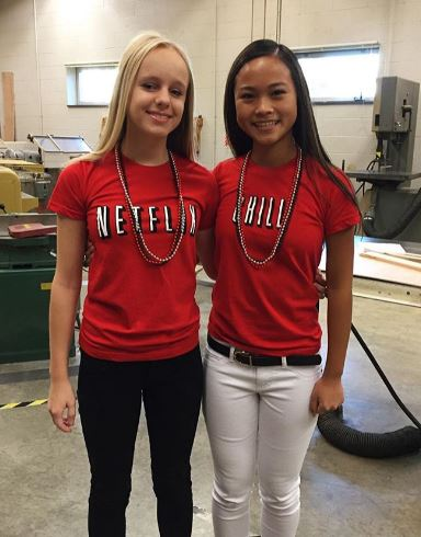 Juniors Emily Hellwig and Jessica McDonald showed some creativity with their red and white shirts. Photo courtesy of Emily Hellwig.