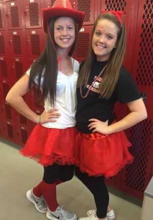 Sophomores Kelly Porter and Maia Weigard pose in red tutus. Photo courtesy of Kelly Porter.