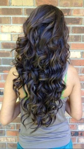 Curly hair left all down is an easy and beautiful way to style your hair for homecoming. Photo by: http://stylesweekly.com/shag-haircuts/