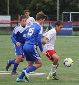 Midfielder and freshman Anthony Maiorano defends the ball from Kennard-Dale opponents.