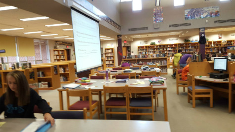 Middle school students and tutors collaborate in the library. Photo By: Francesca Fruti
