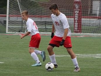 Sophomore midfielders Brendan Wilson (left) and Adam Rebich (right) take control of the ball.
