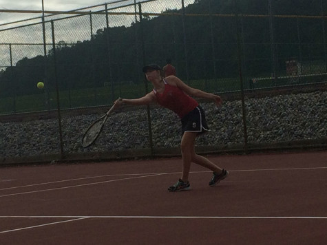 Junior Jenny Sproul has her racket ready to hit the ball.
