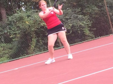 Sophomore Molly Hogan serves a swift ball to her opponent. (Photo by: Emily Rivers)