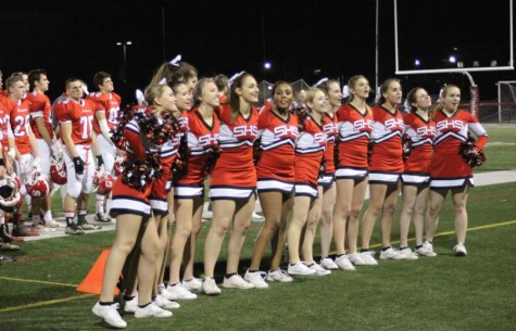 Cheerleaders sing the Susquehannock Alma Mater together. Photo by Karly Matthews.
