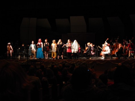 The Halloween concert is one where students are allowed to wear a costume of their choice, rather than the formal black that is expected for other concerts. Each section of the high school orchestra went out to display their costumes to the crowd. The viola section is featured in this photo.