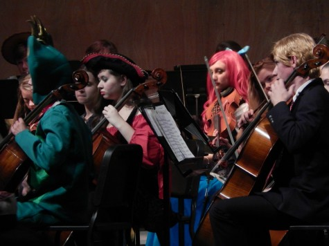 Some of the members of the high school orchestra performing.