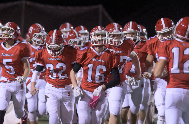 The+Warriors+running+onto+the+field+before+their+game+against+Northern.+Photo+by+Lifetouch.