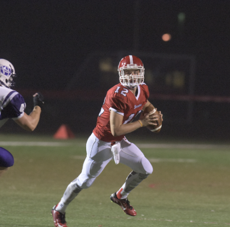 Senior quarterback Josh Stoneberg looks for a pass against Northern. Photo by Lifetouch.