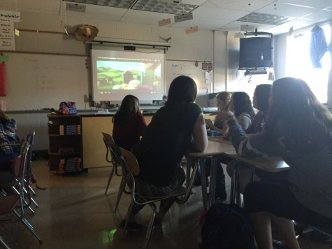 Members watch a video detailing the holiday. Photo By: Karly Matthews