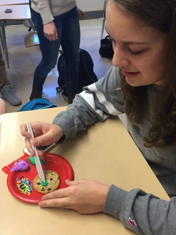 Senior Robyn Chandler decorates a cookie in the spirit of the holiday. Photo By: Karly Matthews