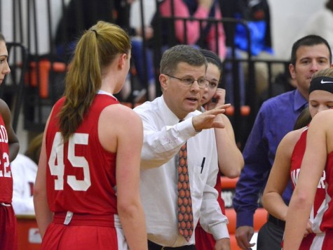 Coach makes a plan during a timeout. Photo By; Nathan Rhoades from Avon, IN