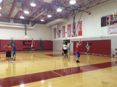 Some players from the team doing a shooting drill during practice. Photo by Ally Kerr.