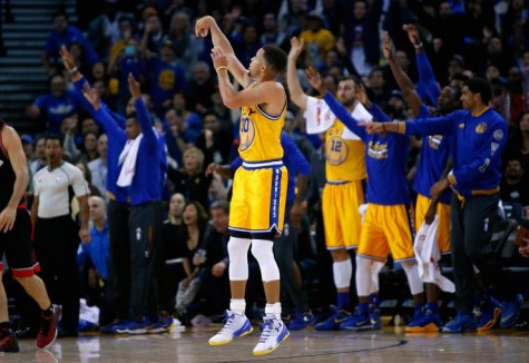 Curry popping a three in front the warrior bench. Photo By Kevin Burkett.