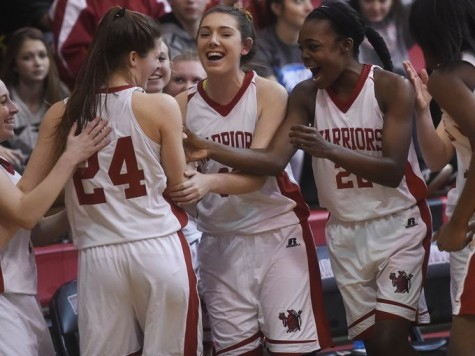 Team cheers on Williams after three point buzzer beater! Photo By; GameTimePa