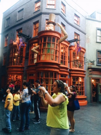 The Weasley's candy shop stands out in Diagon Alley.