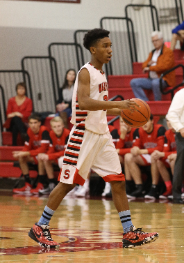 Sophomore guard Jordan McMillion getting ready to run a play during a game. Photo by Mike Inkrote.