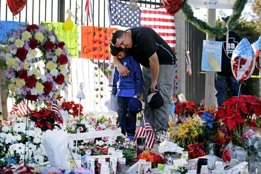 A family visits a memorial honoring victims of the San Bernardino shooting. Photo by Jae C. Hong/AP.
