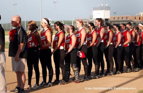 The Warrior Softball team stands during the National Anthem before round one of districts last season against Twin Valley. Photo by Kirk Neidermyer.