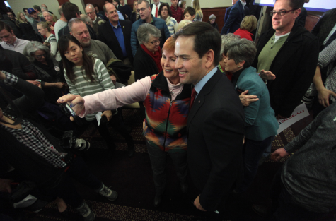 A supporter snaps a photo with Senator Rubio. Photo by Gage Skidmore from Peoria, AZ, United States of America - Marco Rubio with supporters, CC BY-SA 2.0.