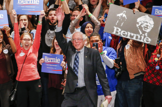 Bernie Sanders speaks to supporters at a rally. Photo courtesy Erik S. Lesser/Corbis.
