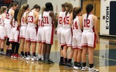 Girls basketball lines up for the national anthem.