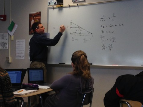 Lewis enjoys sharing his knowledge with his students. Photo By Grace Burns