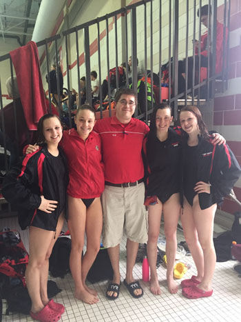 Students pose with their swim coach, WIngert