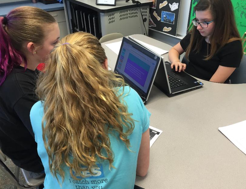 Students (left to right) Ella Blake, Noelani Franklin and Paige Krobot work on Google Slides. Photo by Karly Matthews.