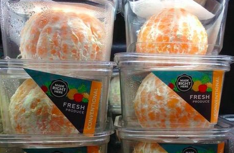 Whole Foods is selling pre-peeled oranges. Photo courtesy of Getty Images.