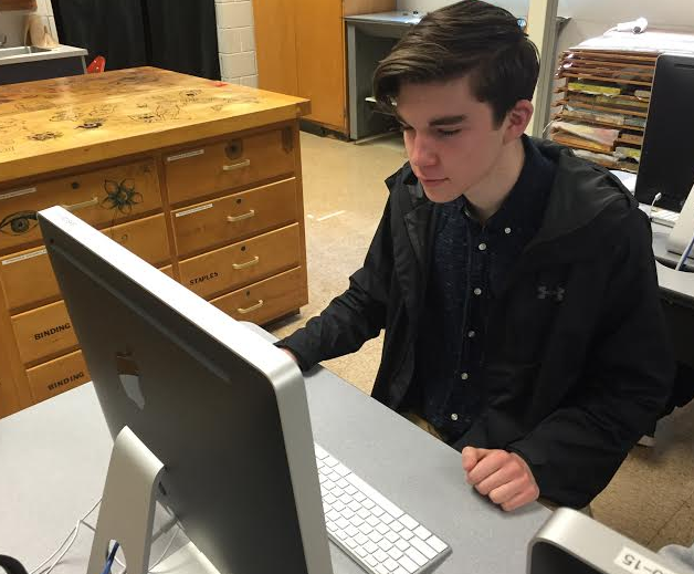 Smith works on a new graphic with Adobe Illustrator. Photo by Karly Matthews.