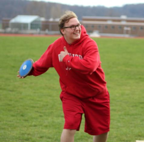 Athlete Alex Maynard gets ready to throw.