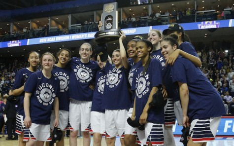 UCONN raises their championship trophy. Photo By: Karolina A. Martinez [Public domain]