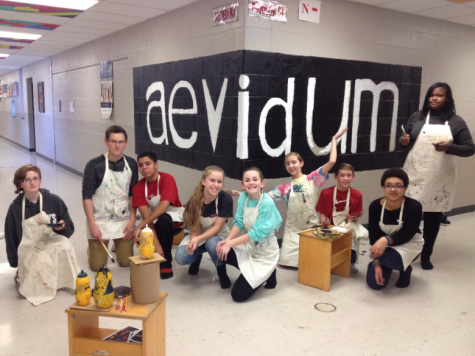 Aevidum members pose in front of their completed mural. Photo courstesy of Lisa Hall