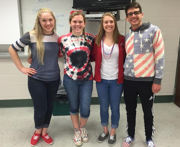 Junior Logan Garvey and seniors Maggie Kaliszak, Kelly Franz and Ryan Gloeckner don red, white and blue. Photo by the author.