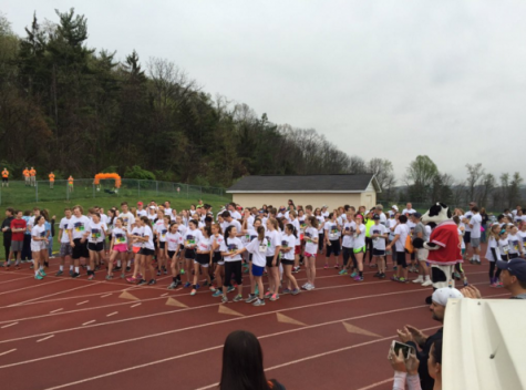 Runners gather around the track before starting the Color Run. Photo by Kelsey McCullough.