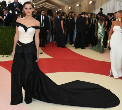 Emma Watson at the 2016 Met Gala walking down the red carpet. Screenshot from E! New's Instagram.