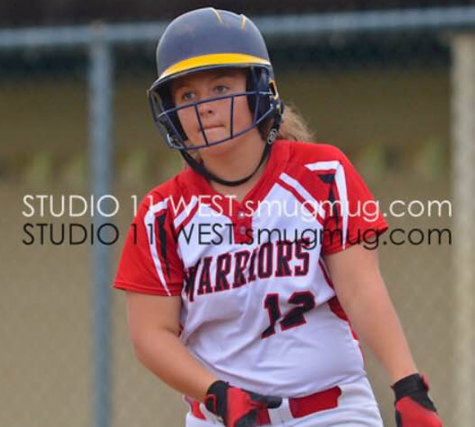 Anna Bryan gets ready to step into the batter's box. Photo By: Studio West Photography