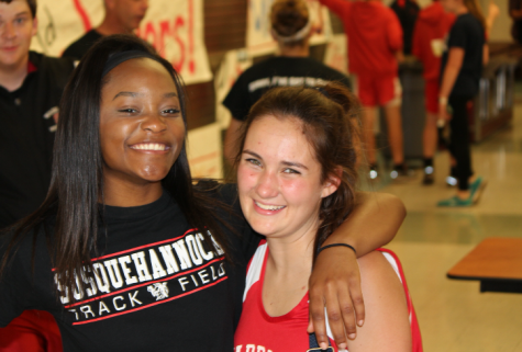 Juniors Danielle Moore(right) and Addy Schefter(left) are pictured at the track and field senior night. Photo Danielle Moore