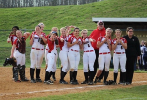 The softball team posing for a picture after their game this week. Photo Mackenzie Gibson