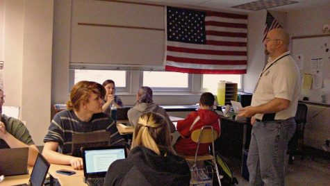 History teacher Adam Hinton prepares his classes with a study guide for the final. Photo by: Ariel Barbera