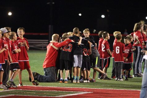 Young players line up on the field. Photo by Laurie Kettinger.