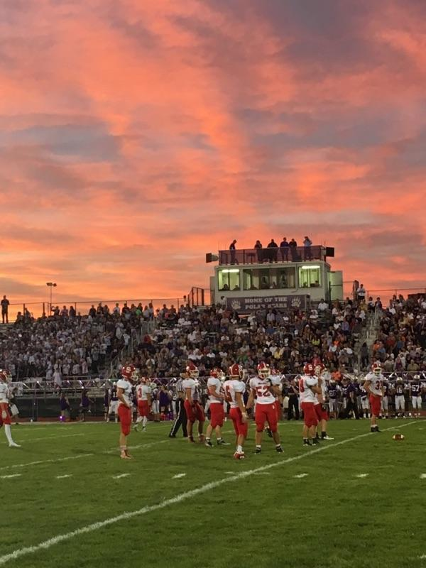 The football team plays intensely at an away game. Photo by: Hailey Miller