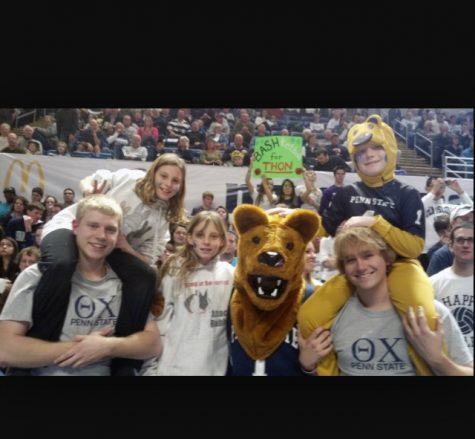 Picture of Annabelle and Alexis Bobby at THON at Penn State University with two fraternity guys. The picture was taken on the floor where dancers stand for 46 hours towards the cause.