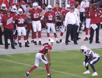 Cardinals Reciever Larry Fitzgerald lines up against Chargers cornerback Brandon Flowers. Photo from Keith Allison