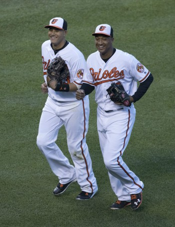 Manny Machado and Johnathon Schoop after ending an inning. Photo from Keith Allison