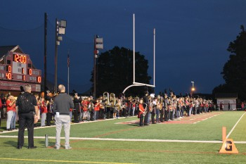 The band performs the National Anthem at the football game. Photo by Mia Kobylski