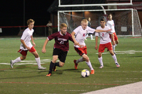 Junior Jason Weger fights for possession of the ball.